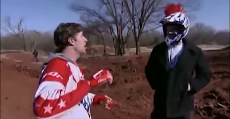 A stuntman tries to explain to Johnny Knoxville how not to die while backflipping a motorcycle