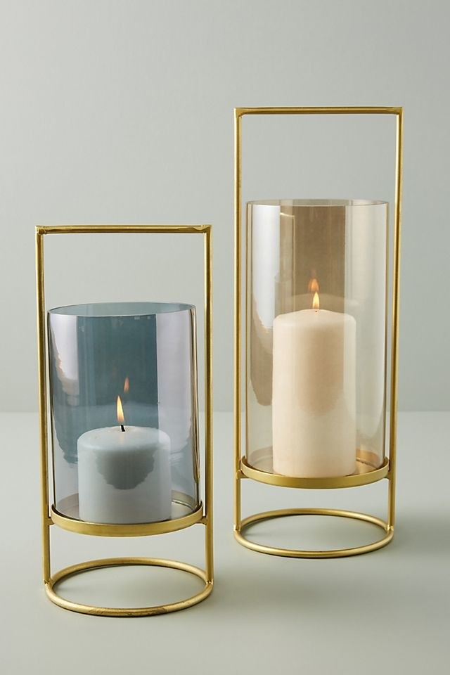 the gold hurricane lights with blue and tan glass accents