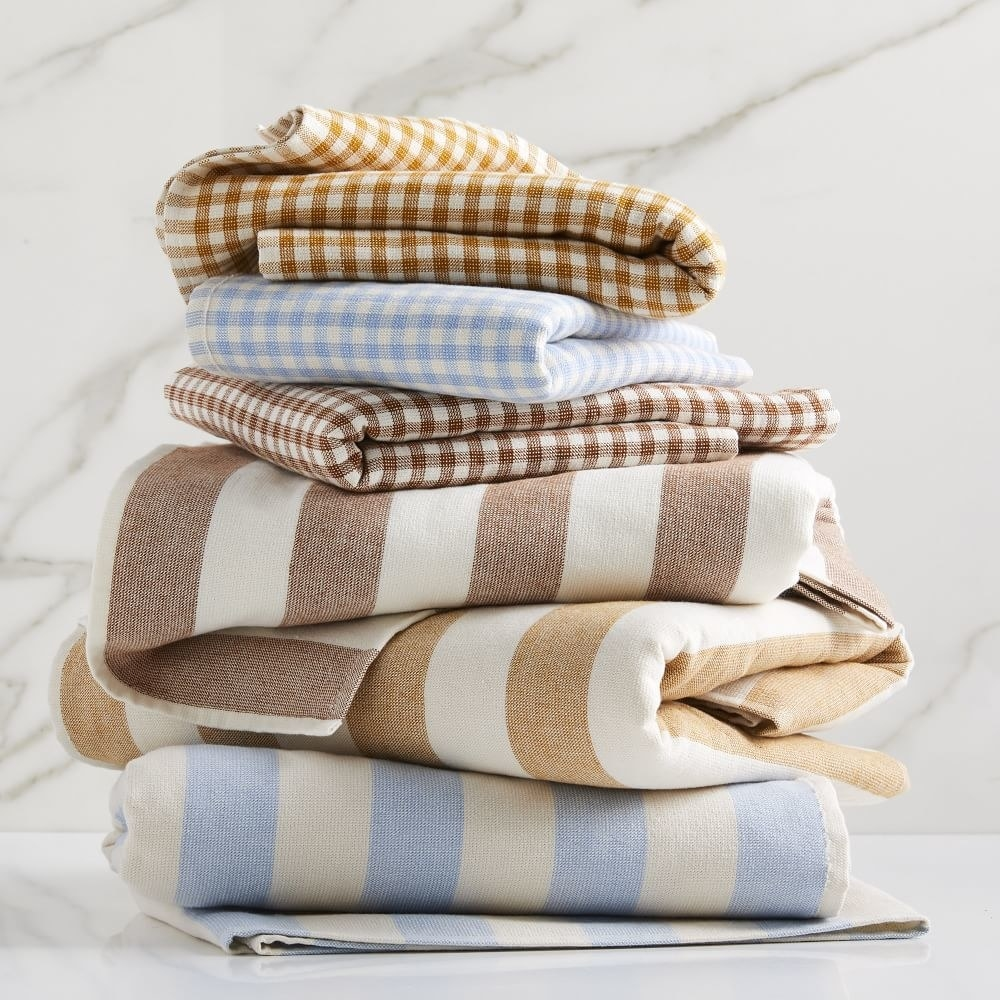 a stack of gingham and striped towels