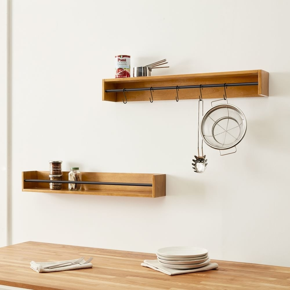 two wood and metal shelves; one placed upright and one facing down