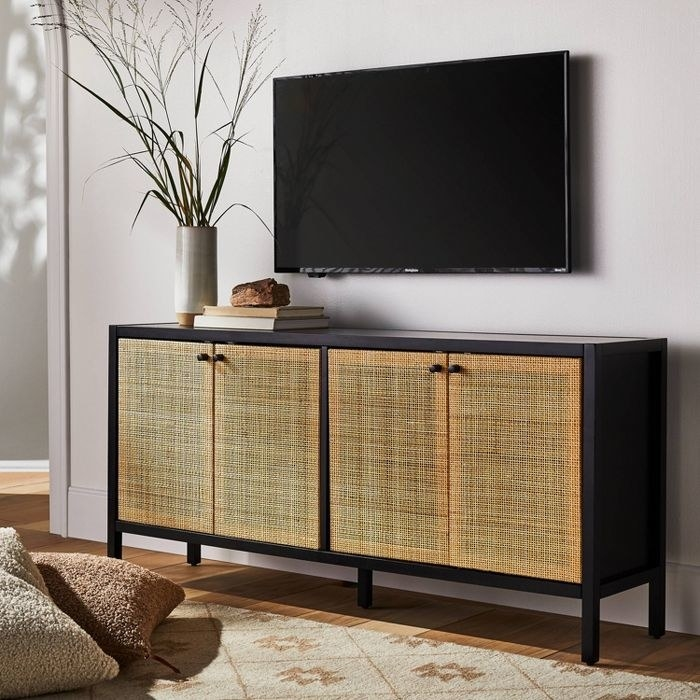 the four-door TV console which has cane finishing