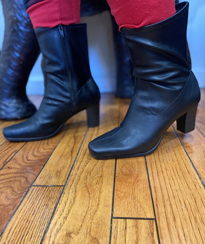 a reviewer wearing the boots