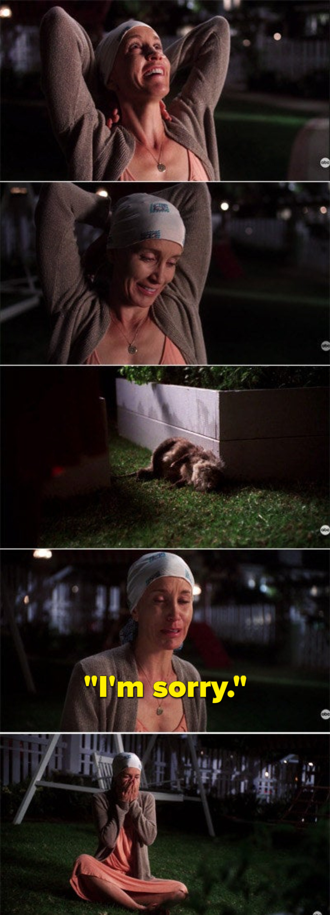 Lynette walking around her backyard sighing in relief, noticing the dead possum, apologizing to it, and sobbing