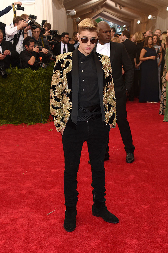 Justin wore an embroidered jacket with matching shirt and pants, as well as sunglasses