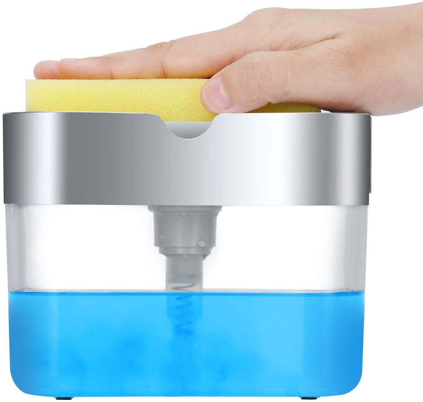hand pushing down on a sponge in a caddy above the soap container