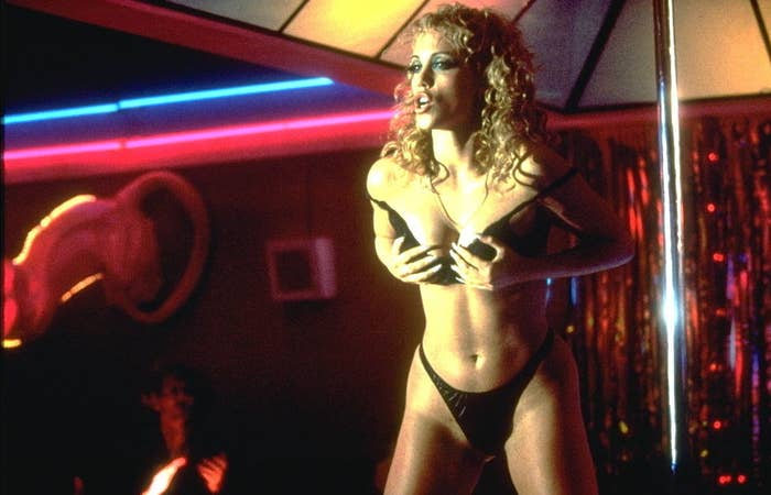 Nomi in Showgirls holding her boobs