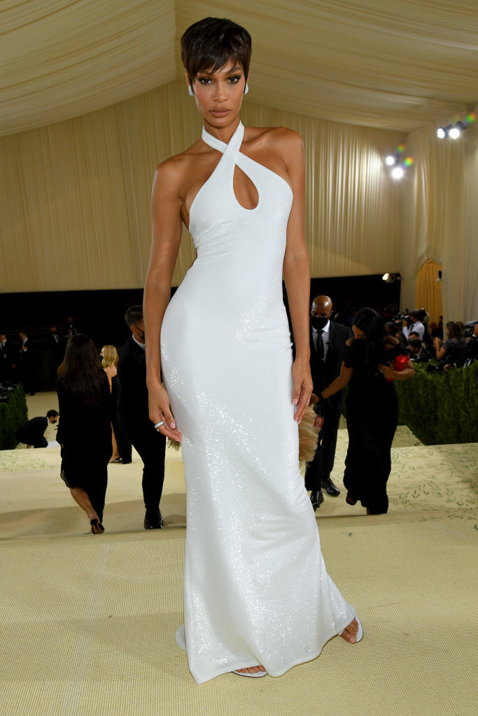Joan Smalls wears a floor length sparkling halter top gown