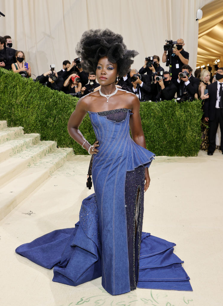 Lupita Nyong'o wears a long denim strapless gown