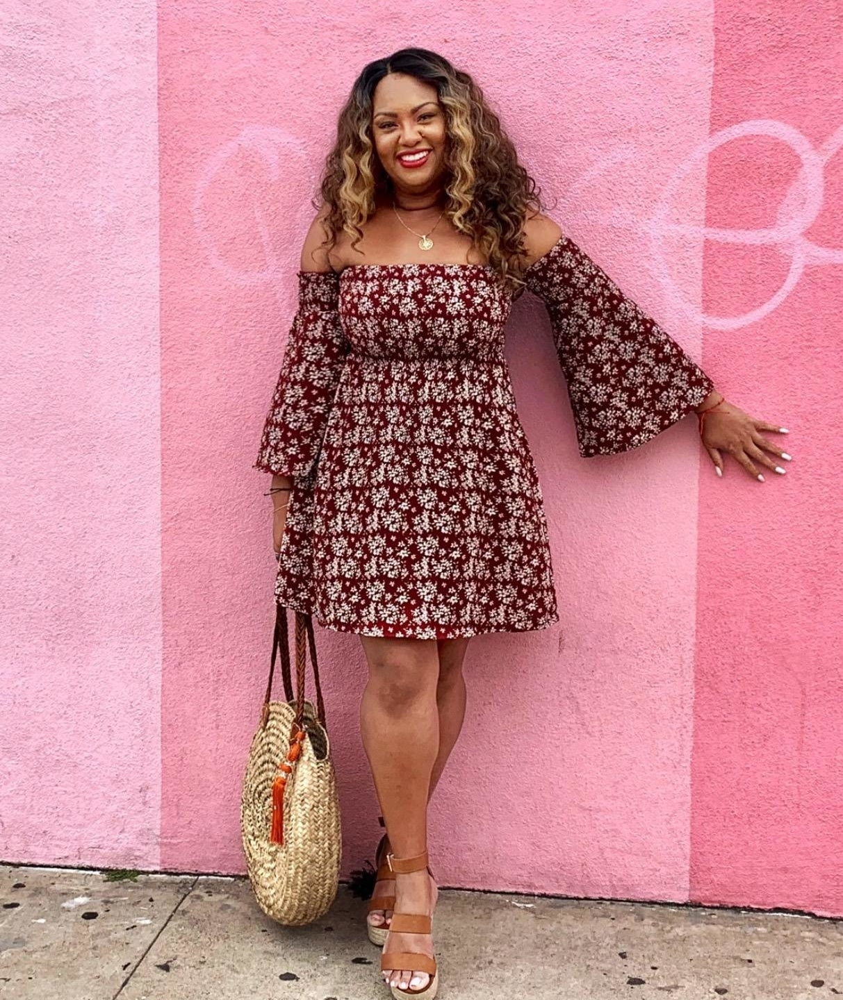 Reviewer wearing the maroonoff-the-shoulder ruched mini-dress