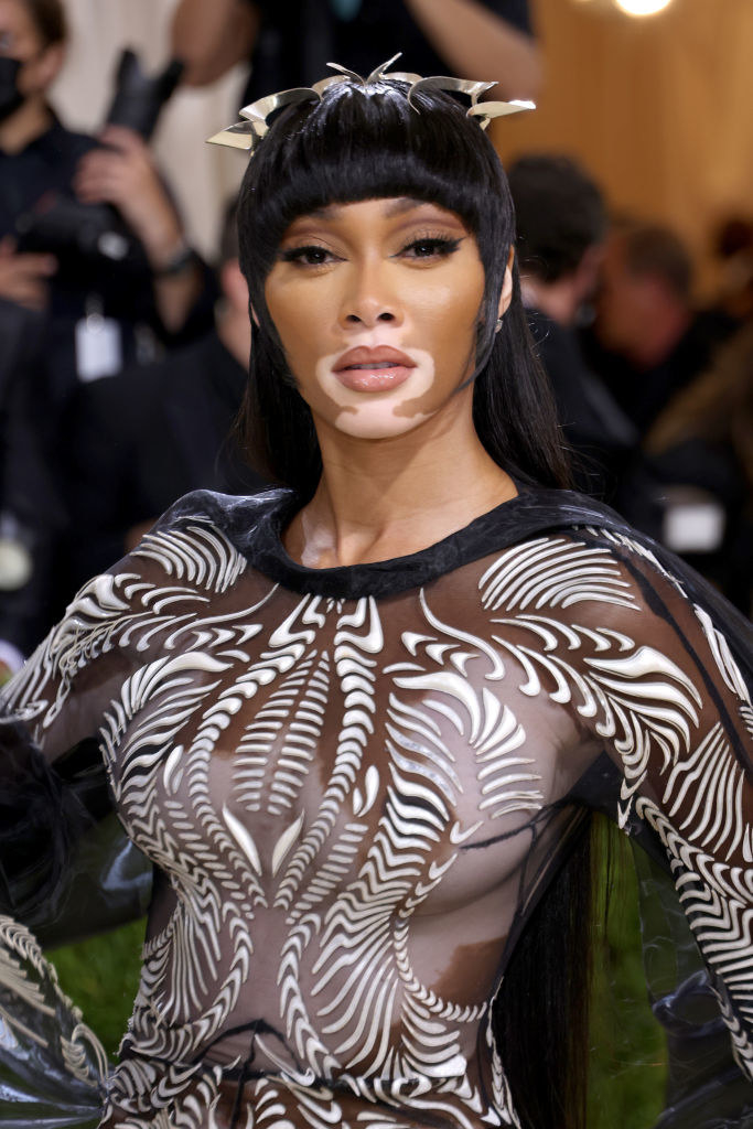 A close up ofWinnie Harlow as she poses on the Met Gala red carpet