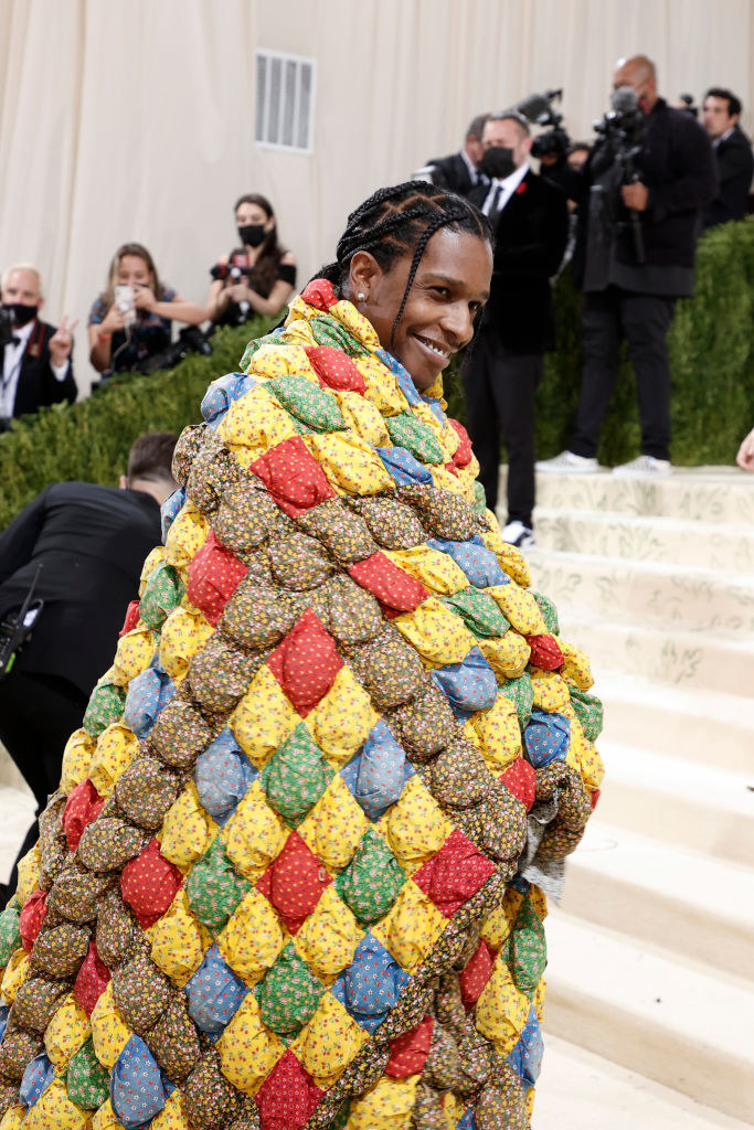 A$AP Rocky smiles while walking up the Met Gala stairs