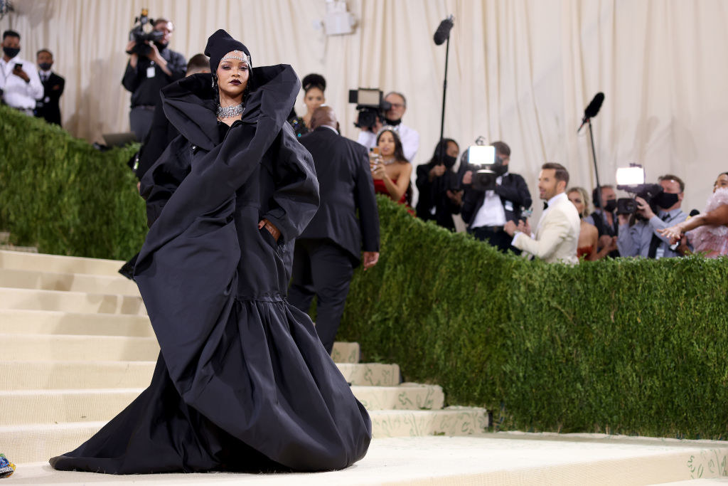 Rihanna wears an oversized gown with a high neck collar