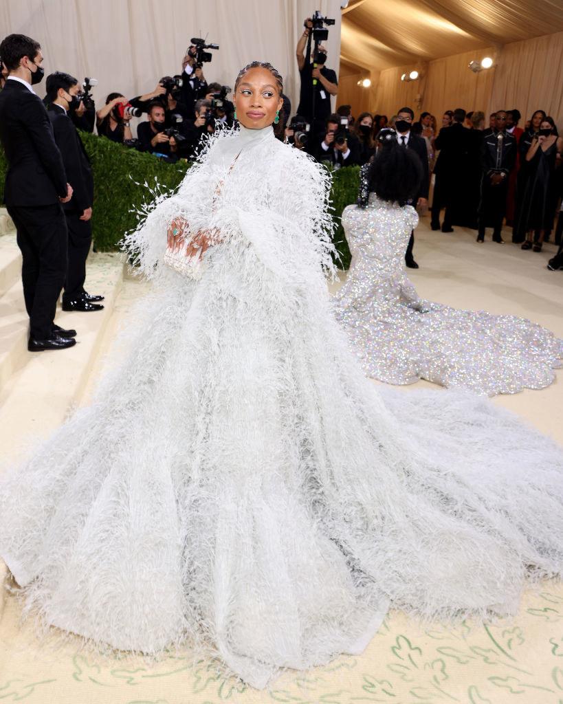Allyson Felix wears a long sleeve fuzzy floor length gown