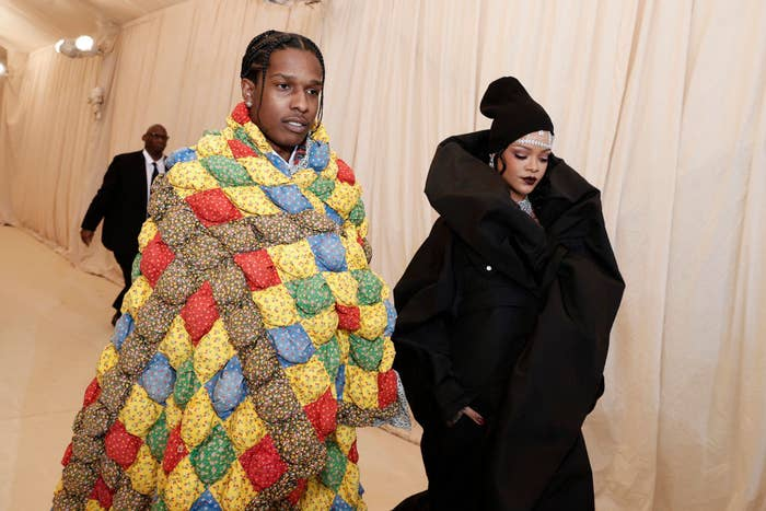 ASAP Rocky and Rihanna walk through a tunnel to arrive at the Met Gala