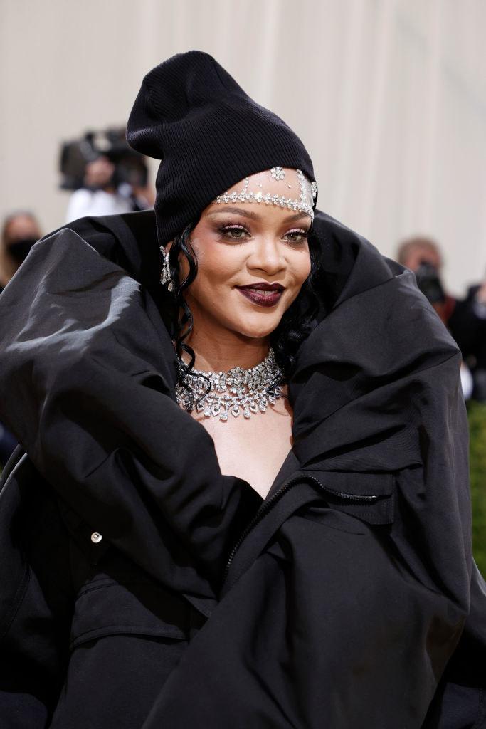 A close up of Rihanna's dark makeup and beanie