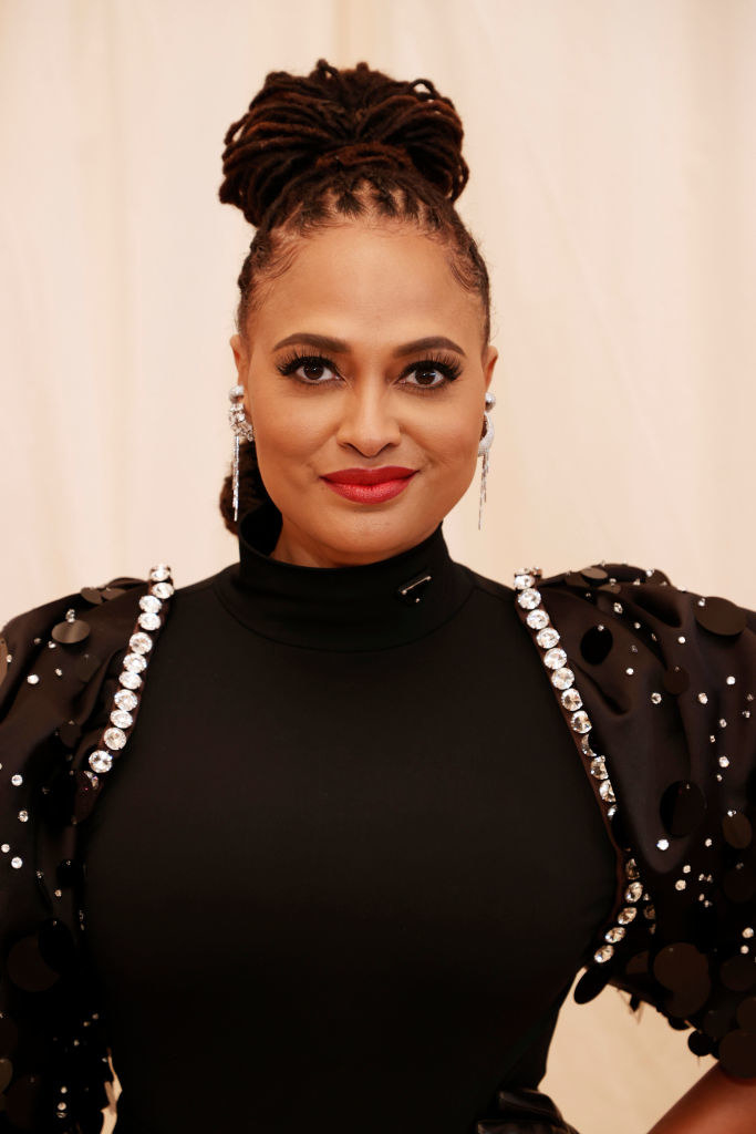 A close up ofAva DuVernay as she shows off her winged eyeliner and bold lipstick