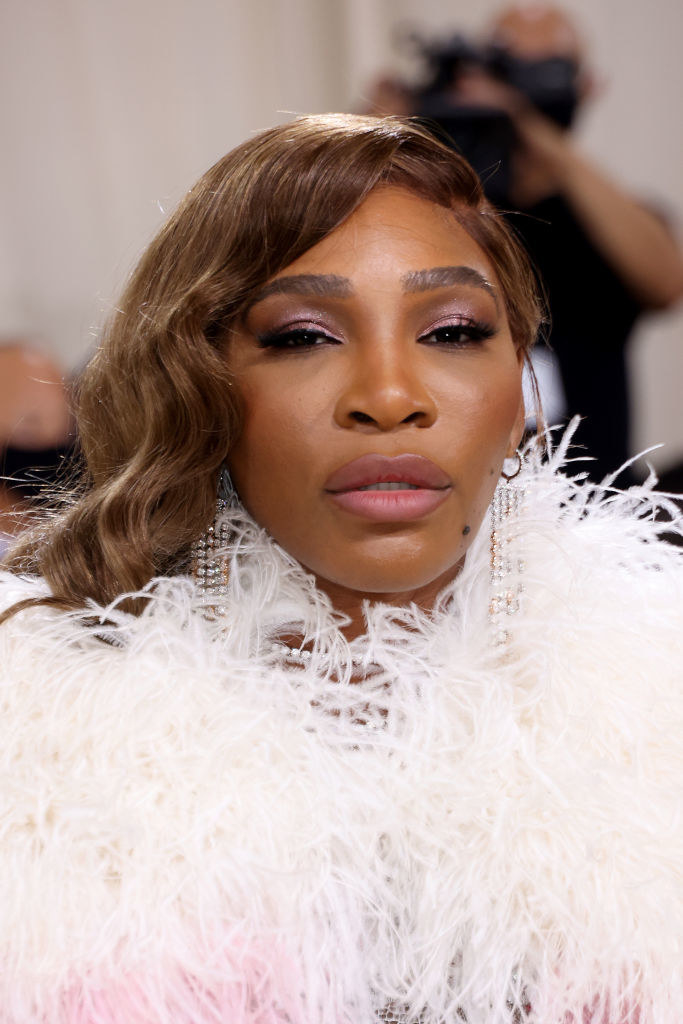 A close up ofSerena Williams as she poses on the Met Gala carpet