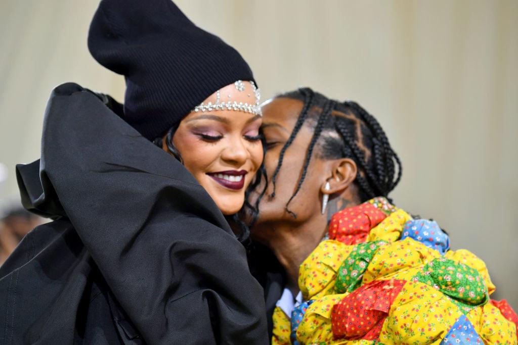 A close up of ASAP Rocky giving Rihanna a kiss on the cheek