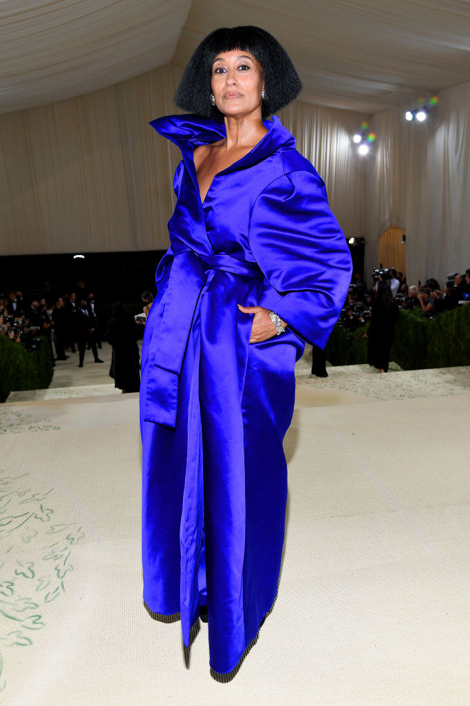 Tracee wore a satin floor-skimming wrapover dress with pockets