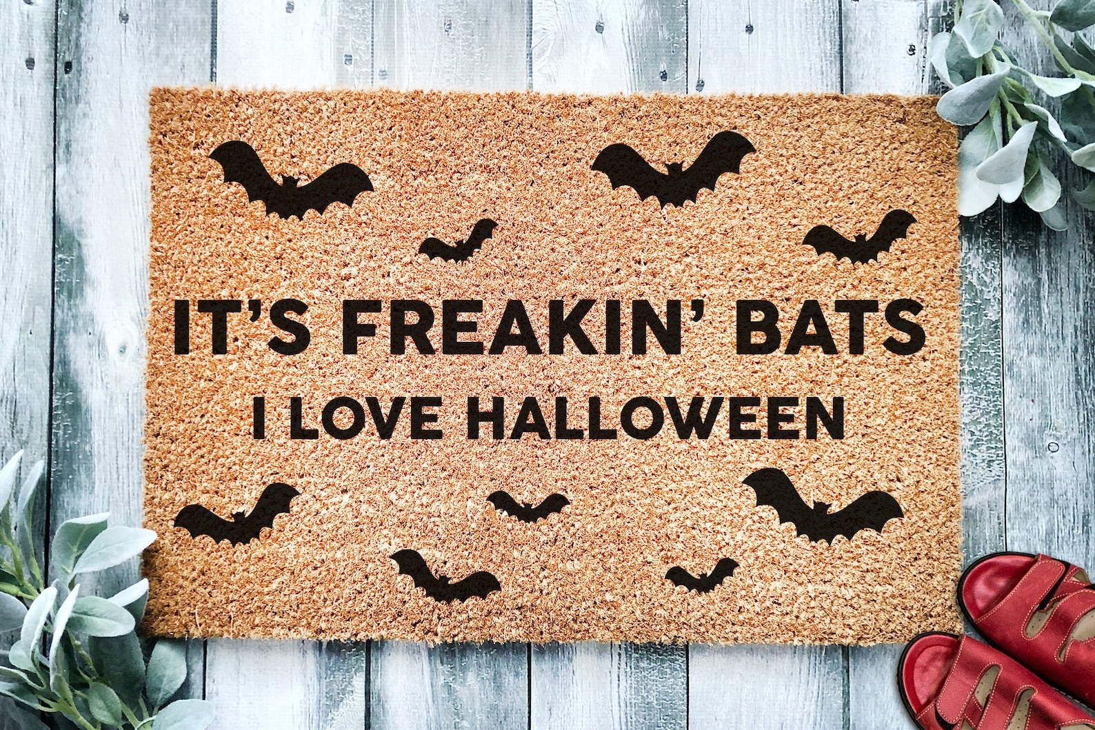 """a doormat with bats and lettering that reads """"it's freakin' bats I love Halloween"""""""