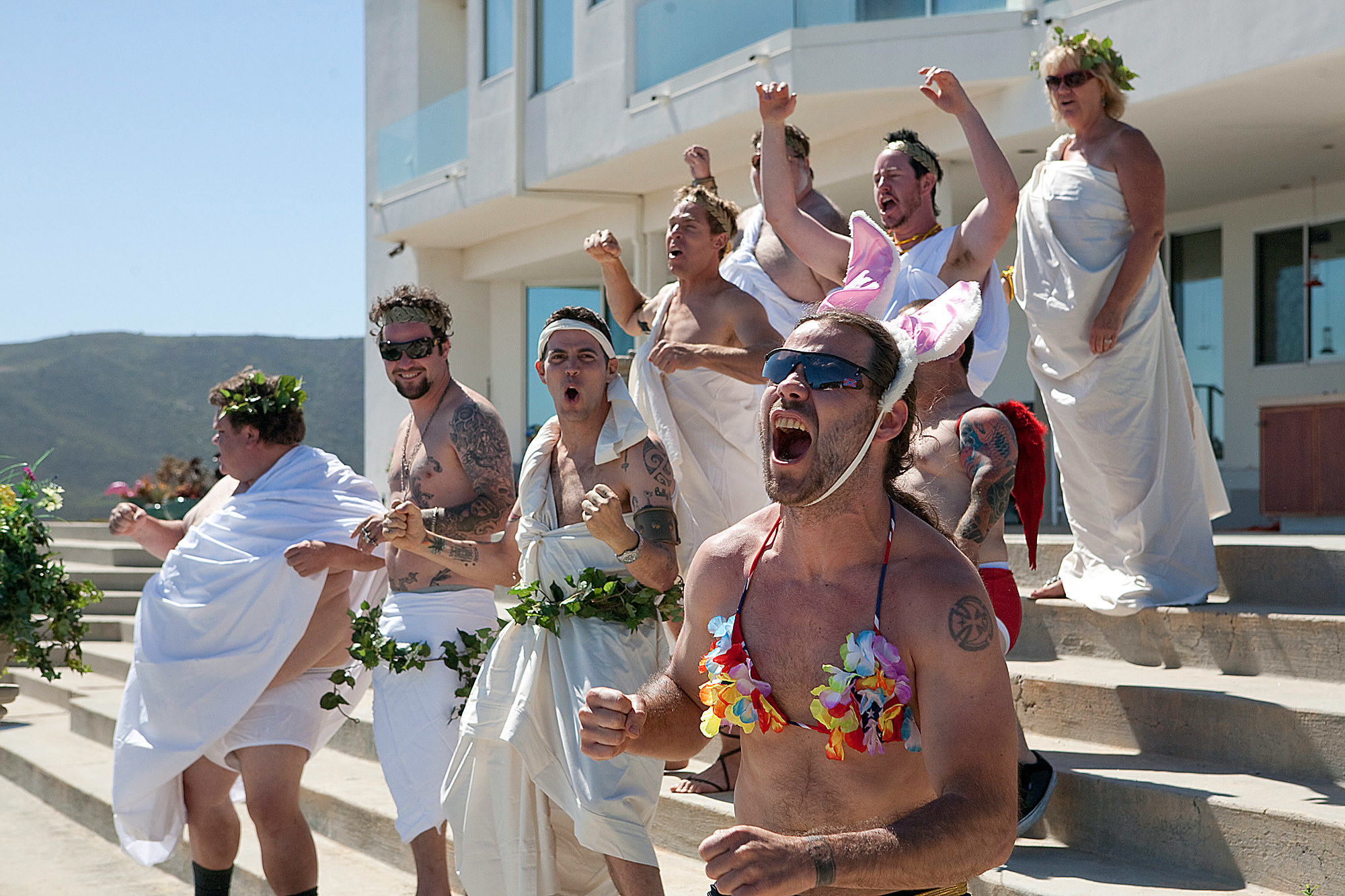 The crew of Jackass at a toga party