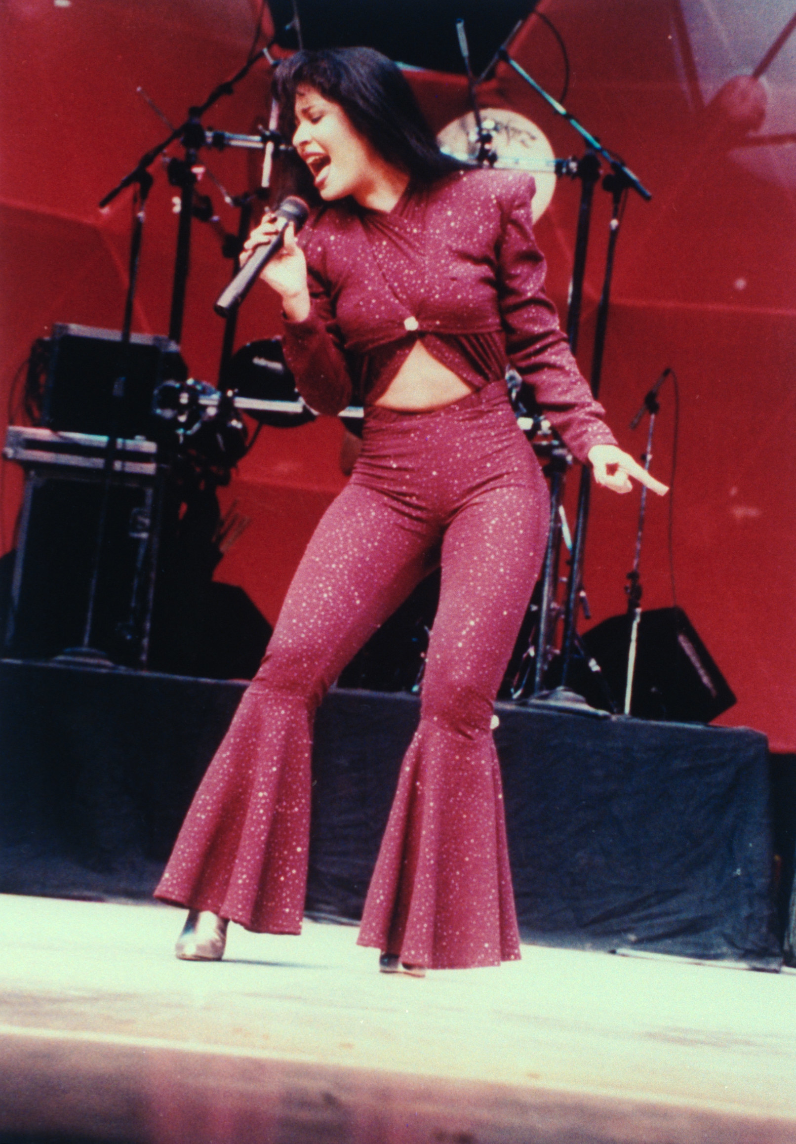 Selena performing in a jumpsuit