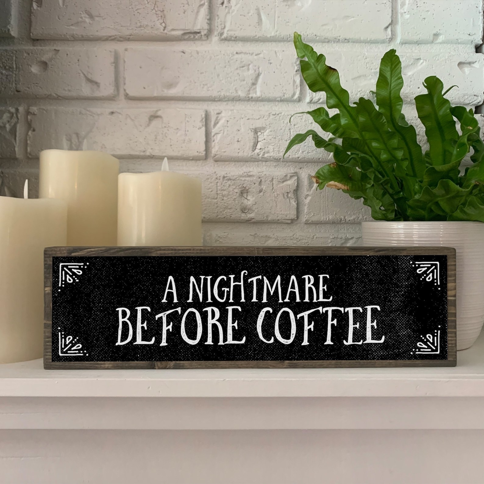"""a wooden sign that says """"a nightmare before coffee"""""""