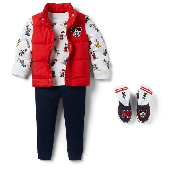 a red puffer vest with mickey on it over a white sweatshirt with disney characters on it