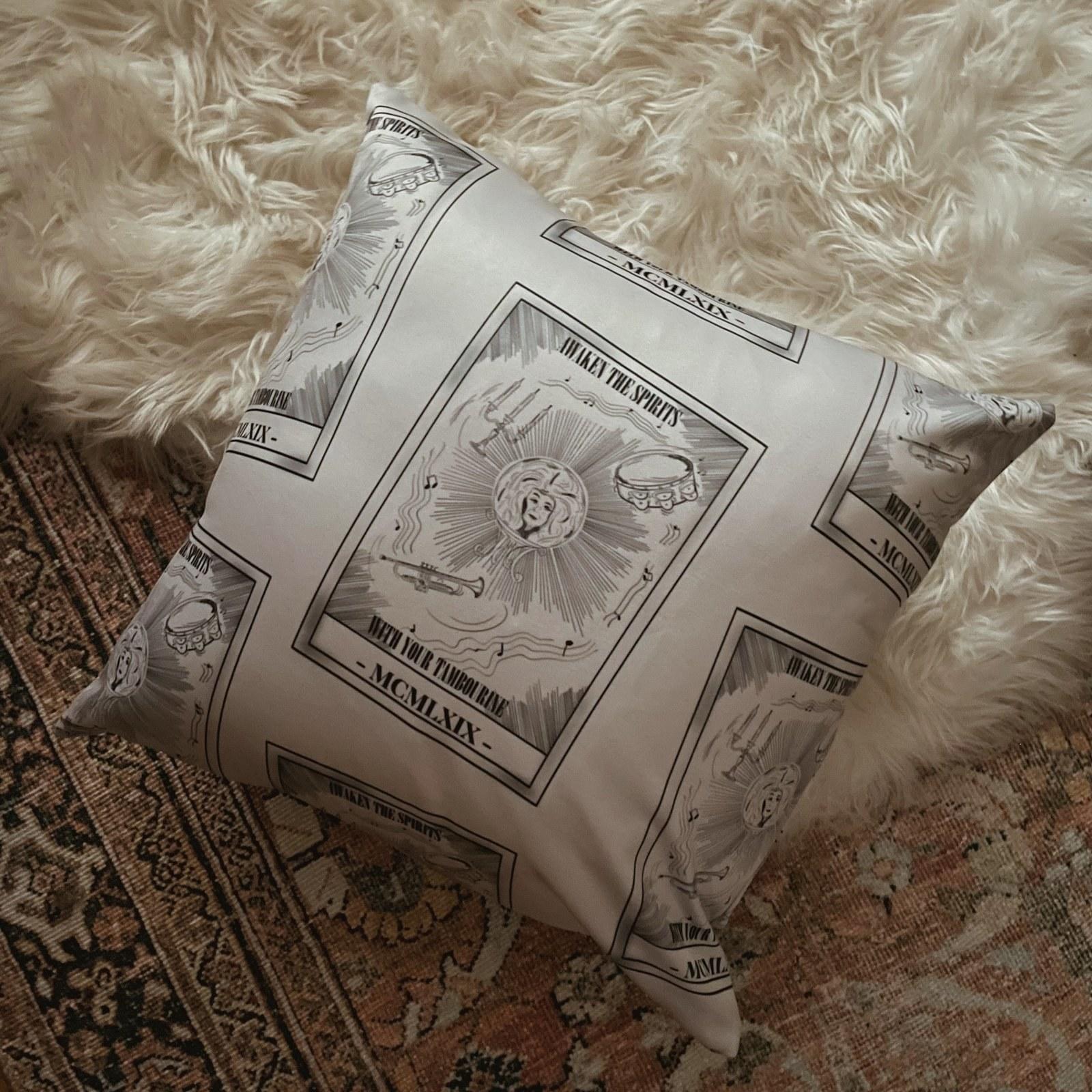 a tan throw pillow with an illustration of madame leota as a tarot card