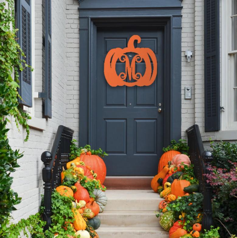 the orange monogram wooden pumpkin on a front door