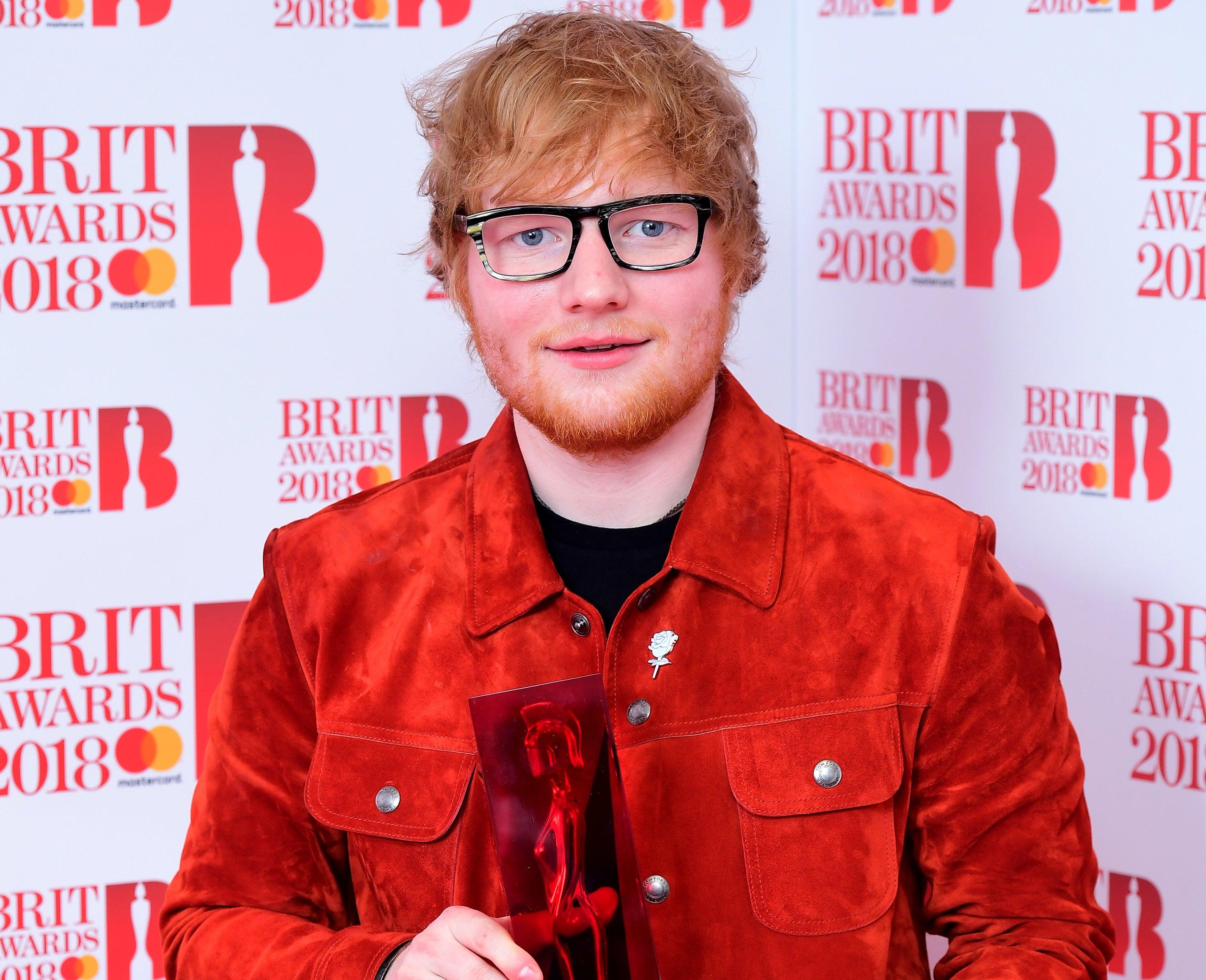 Ed holds up an award at the Brits