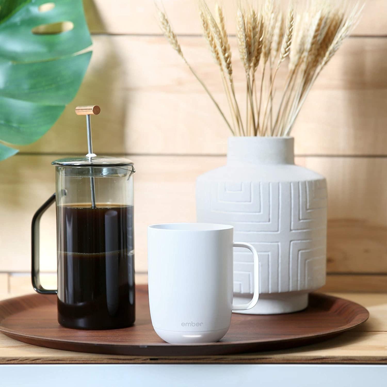 the white mug on a circular wooden tray