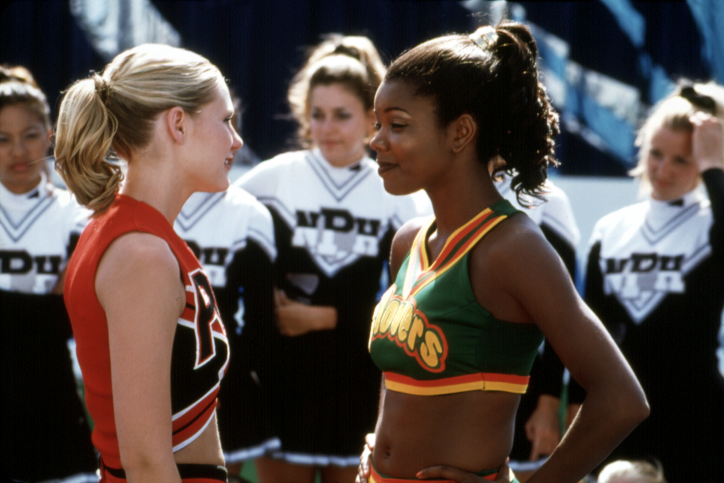 Gabrielle's character stands face to face with an opposing team member