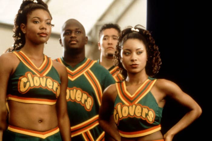 Gabrielle's character wears her green cheerleader uniform in the movie while standing next to her squad members