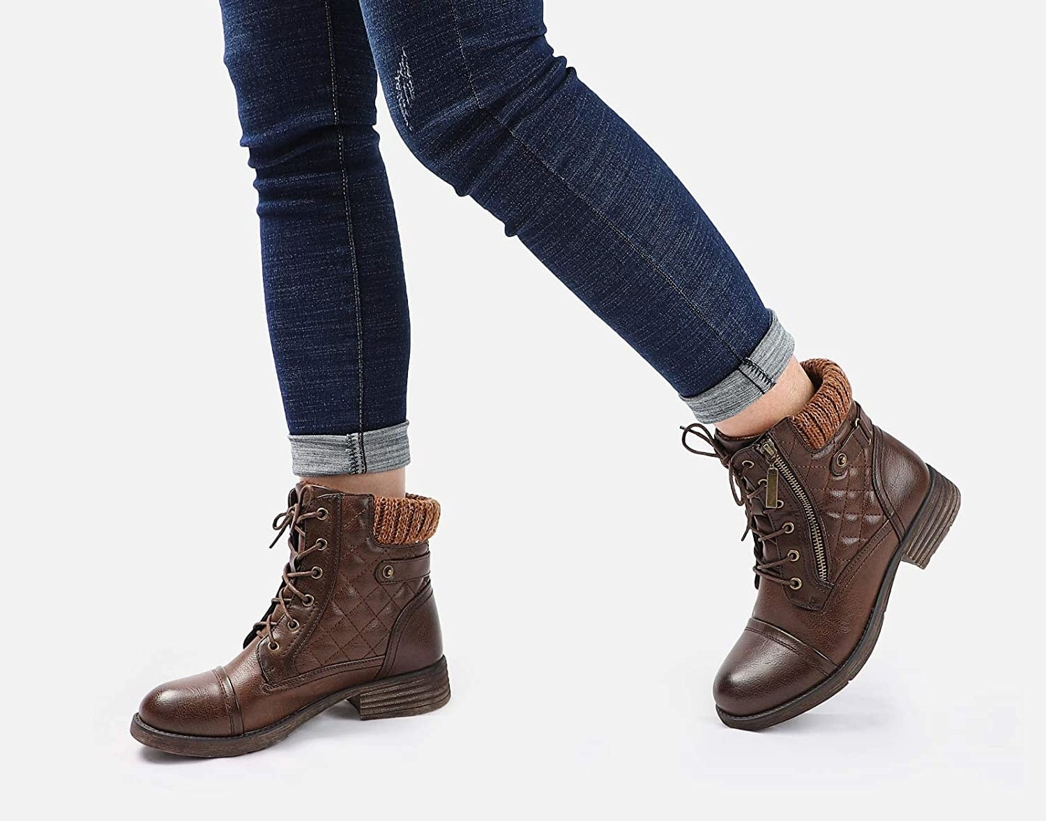 Model wearing the brown boots, which have a quilted side panel and elastic back