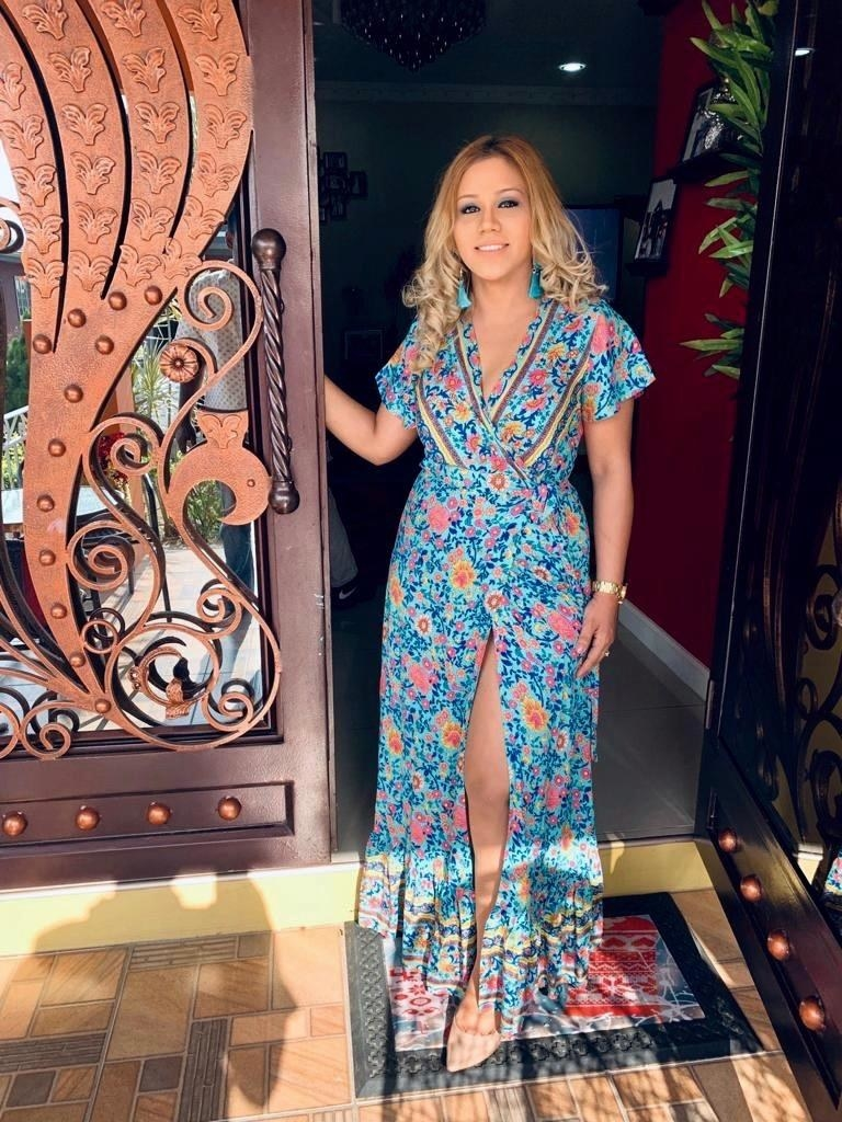 Reviewer wearing the greenBohemian floral printed wrap maxi dress