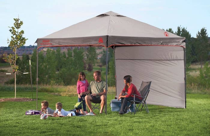a canopy tent with a family inside