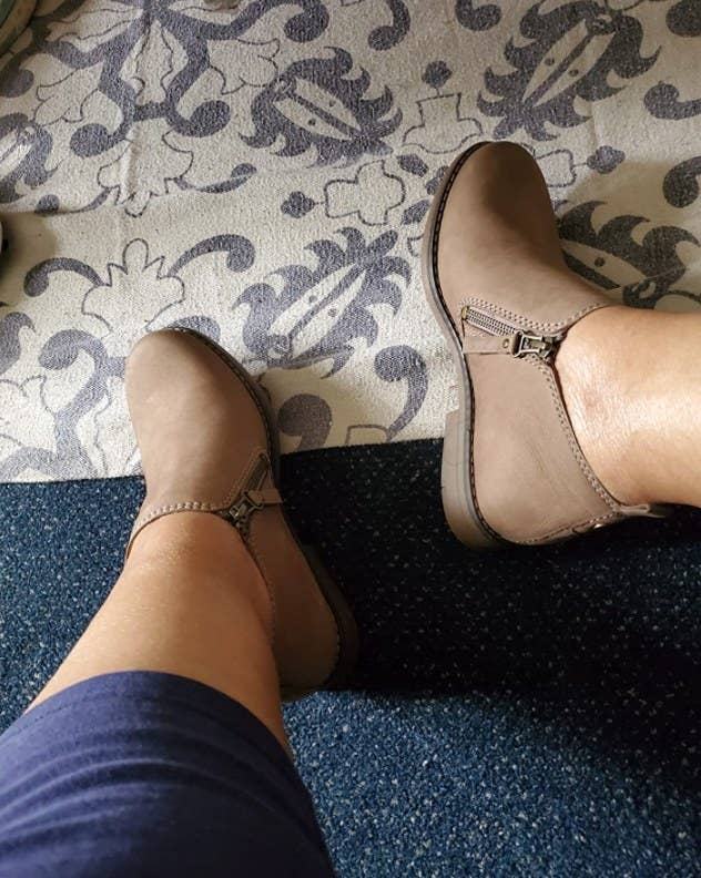 a reviewer wearing the shoes in brown