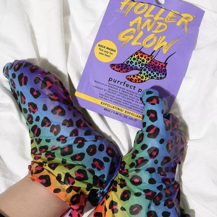 feet wearing rainbow leopard print foot mask