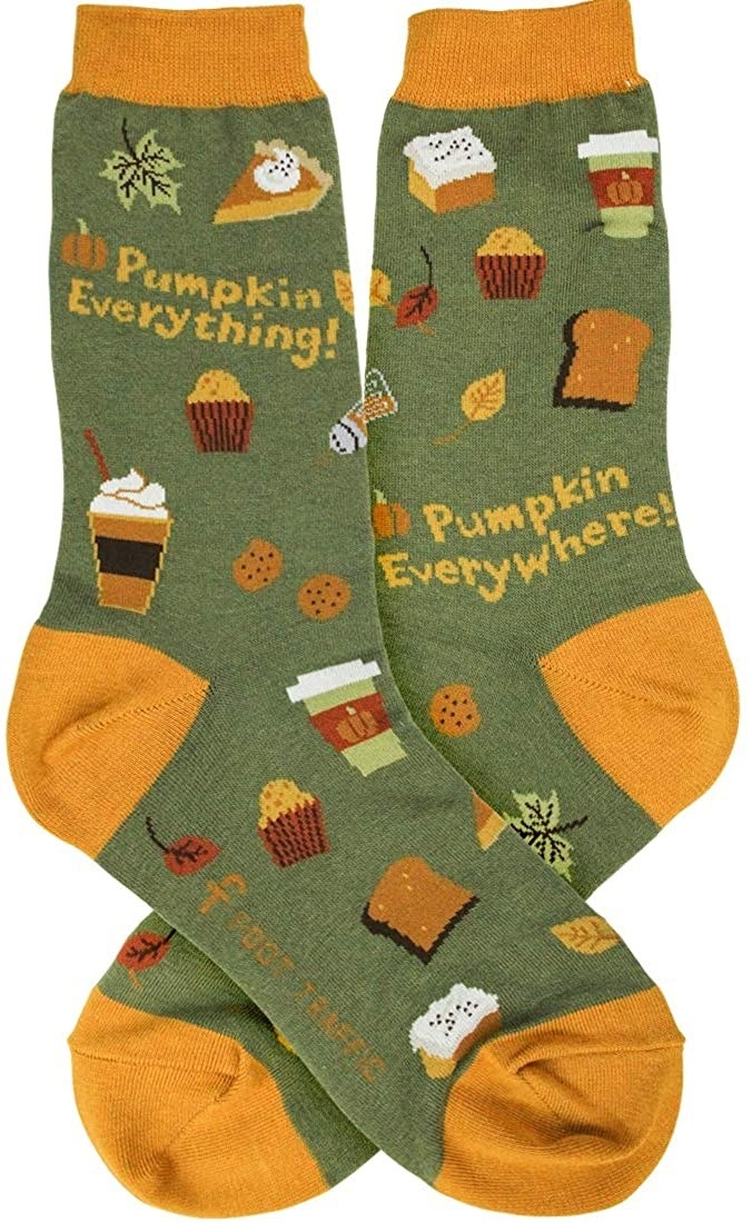 the green and yellow socks which have pumpkin muffins, bread, and coffee on them