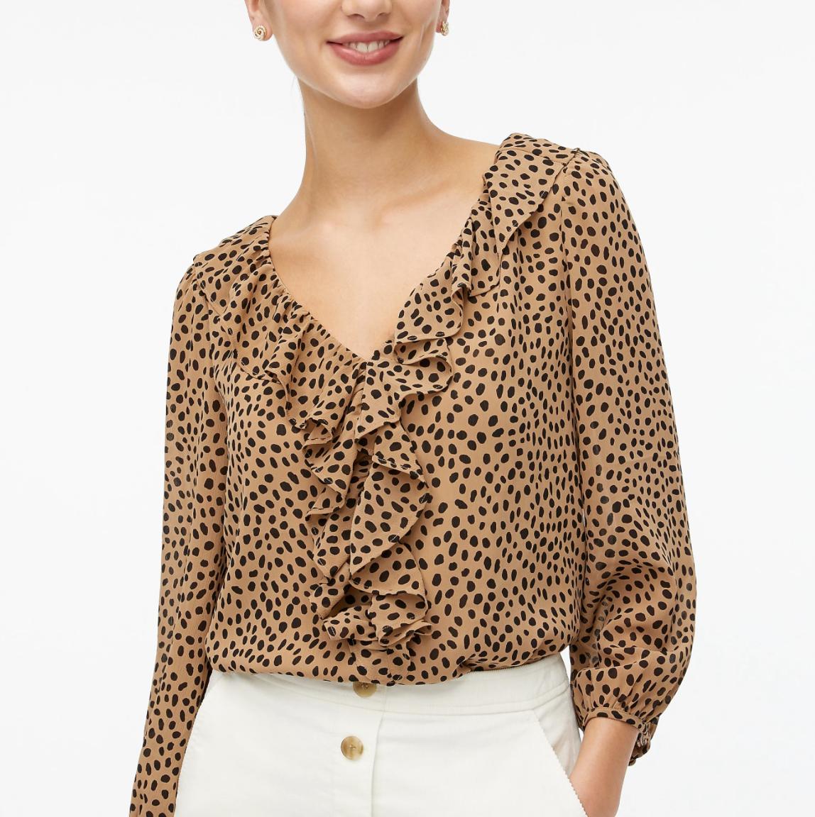 model wearing ruffle neckline V-neck blouse