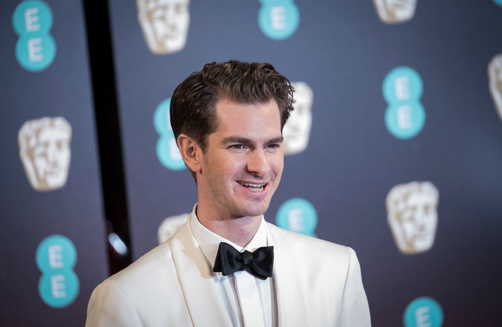 Andrew Garfield attends the 70th EE British Academy Film Awards (BAFTA) in a light-colored tuxedo