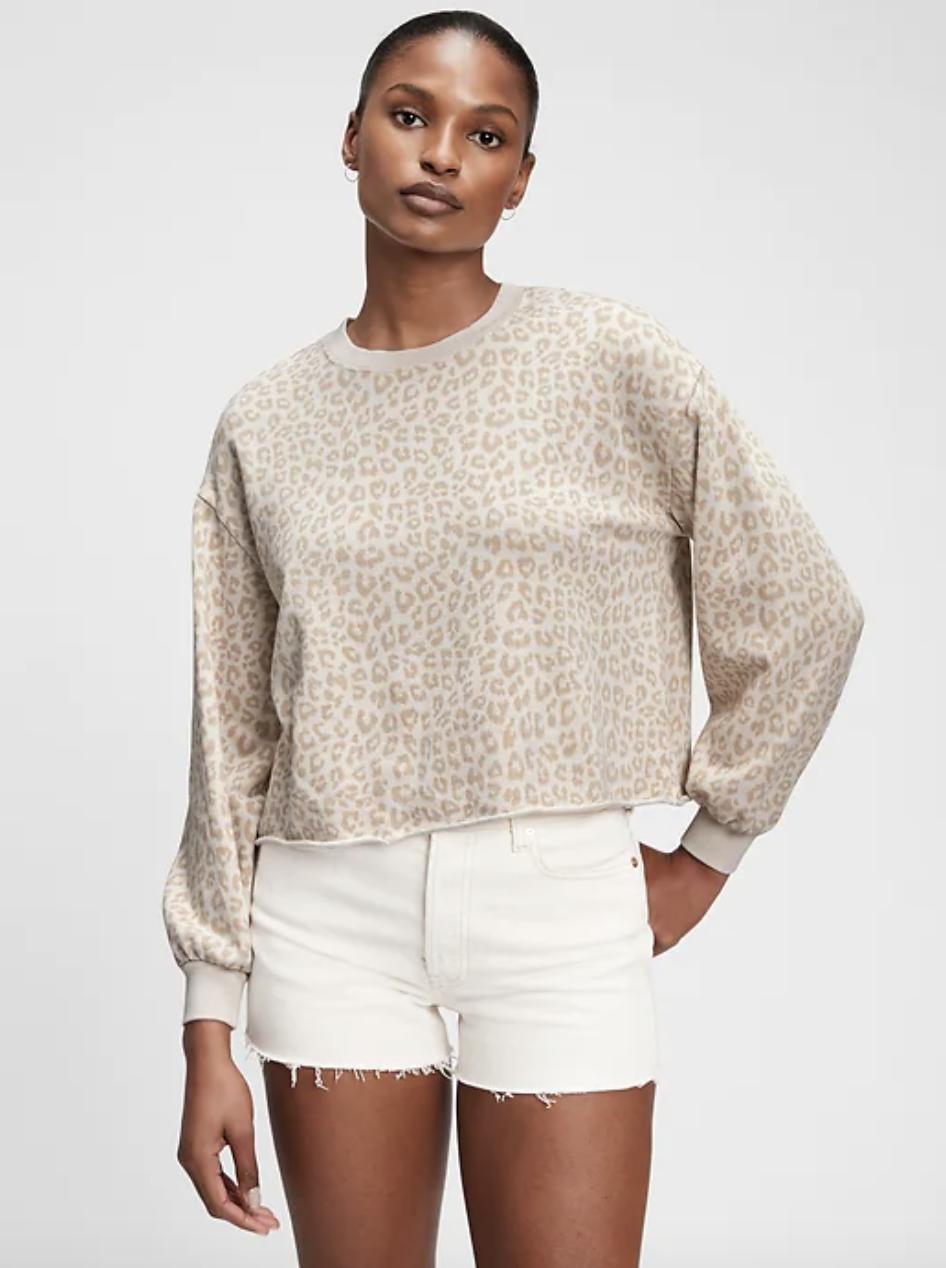 model wearing beige and white leopard print sweatshirt