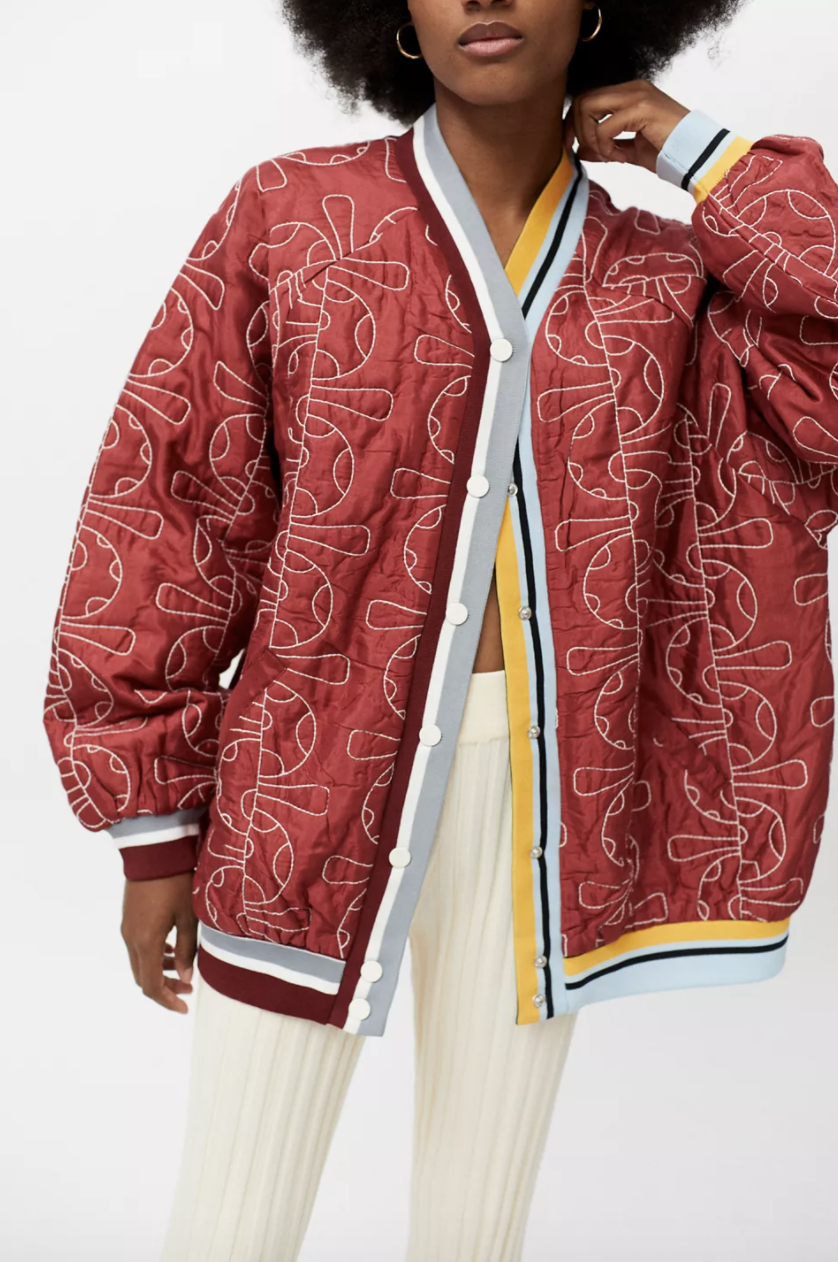 model in varsity style jacket with print on it