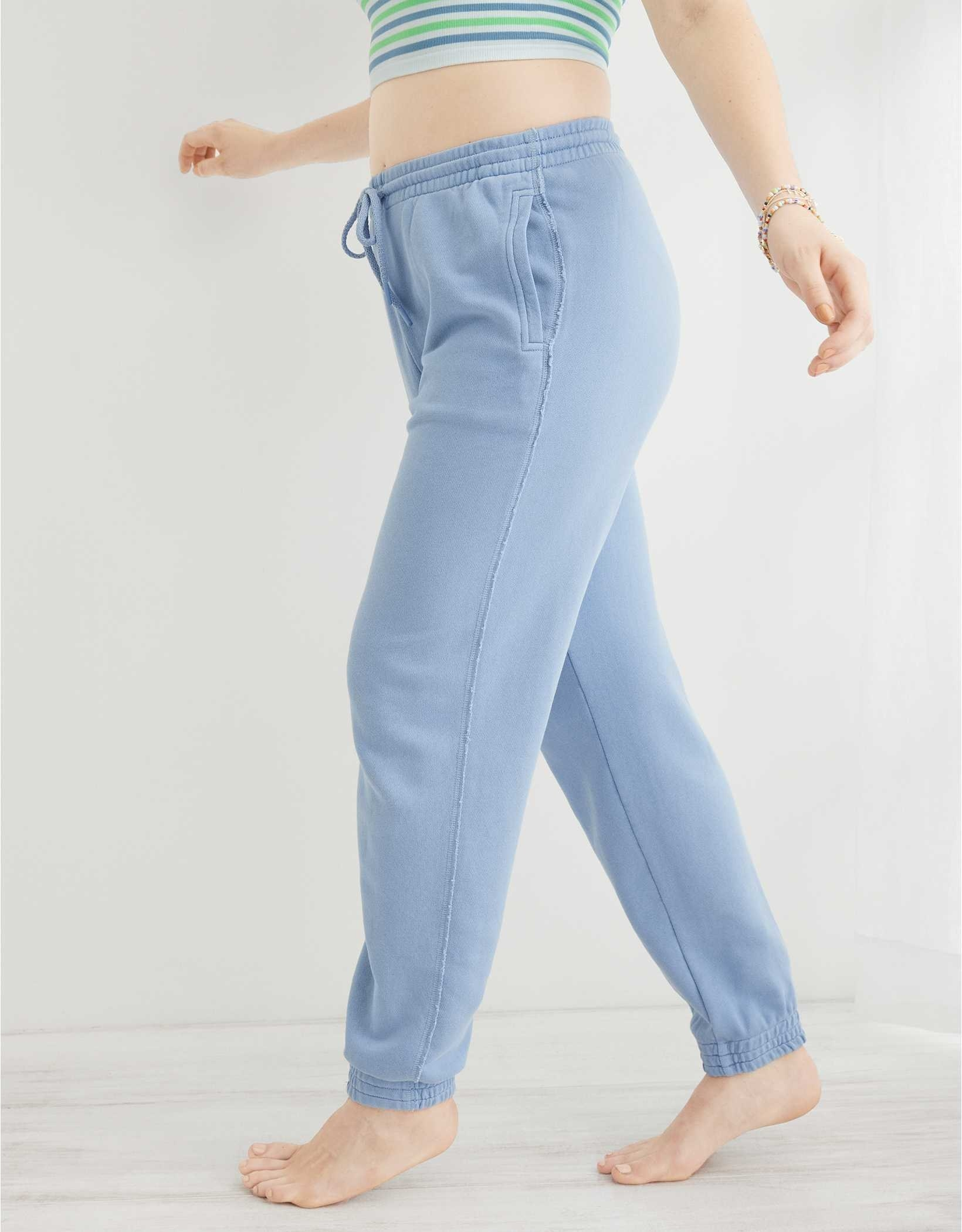 model in high waisted jogger sweatpants