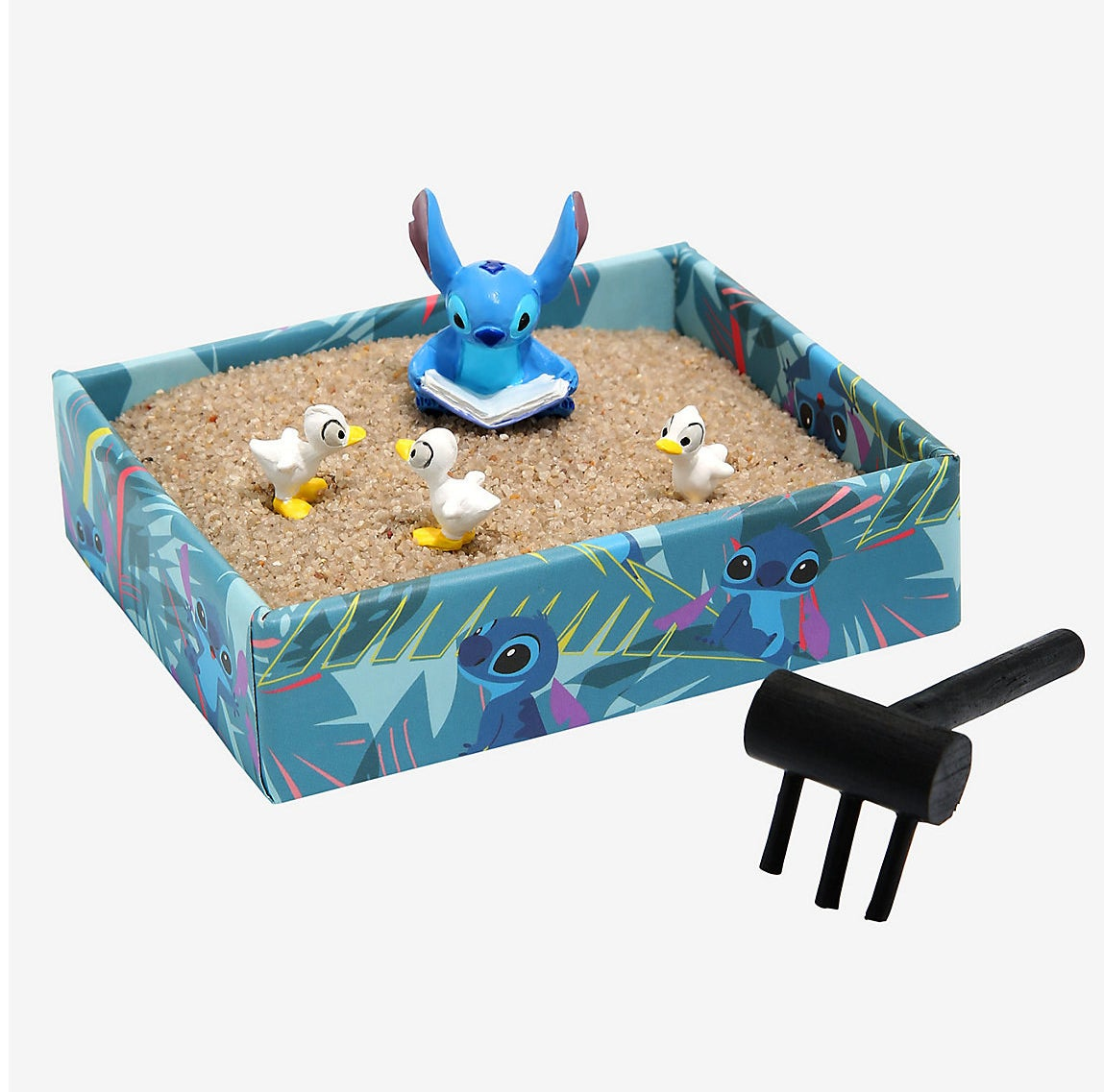 a sand box with stitch in it with ducks