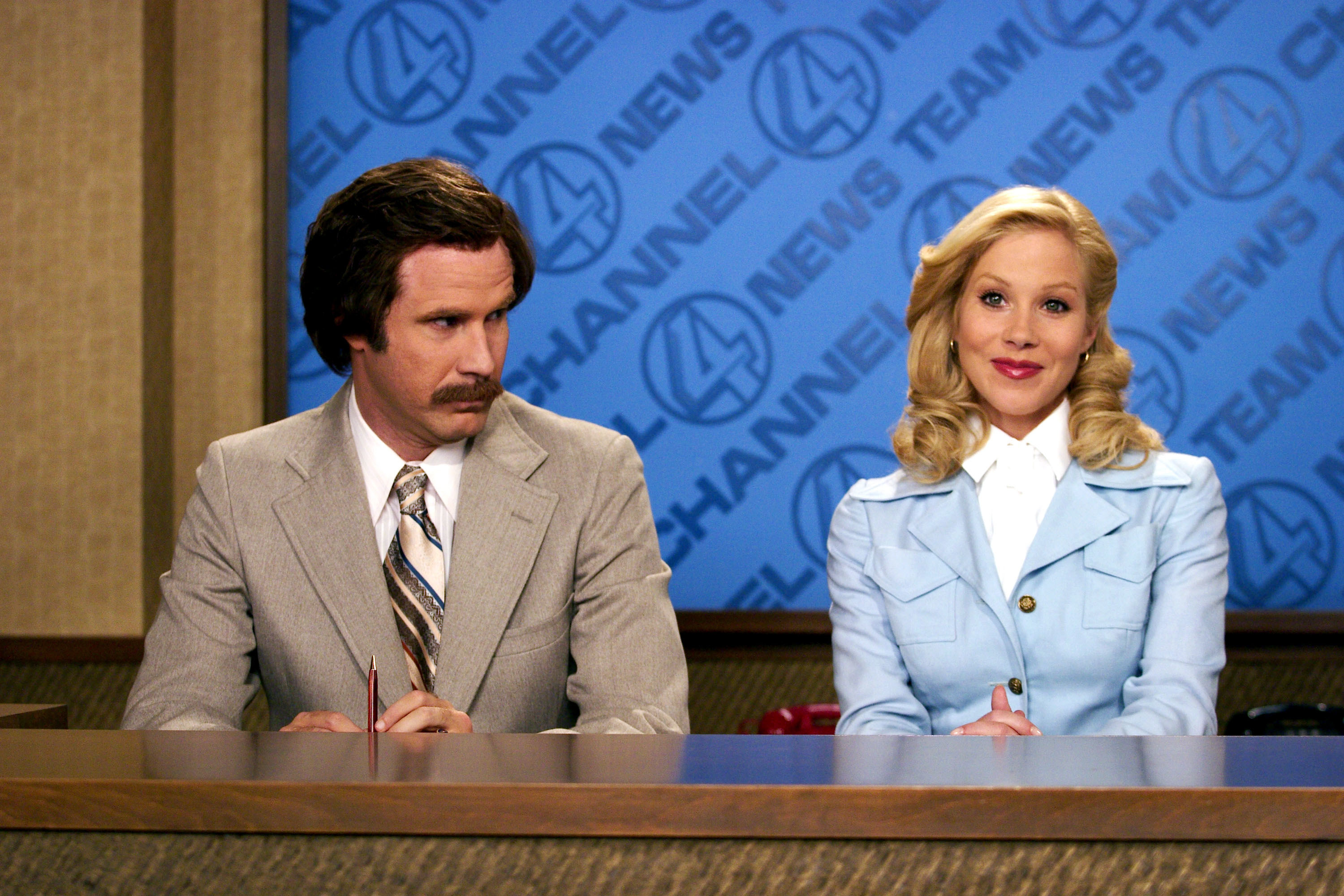 Will Ferrell and Christina Applegate sit behind a news desk