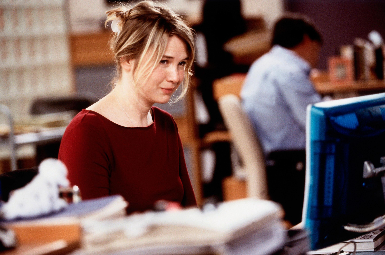 Renée Zellweger sits at a computer