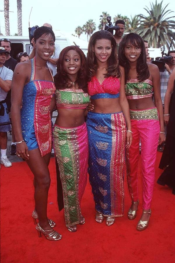 Destiny's Child all wearing coordinating outfits on the red carpet