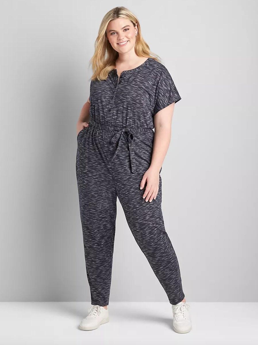 Model wearing grey jumpsuit